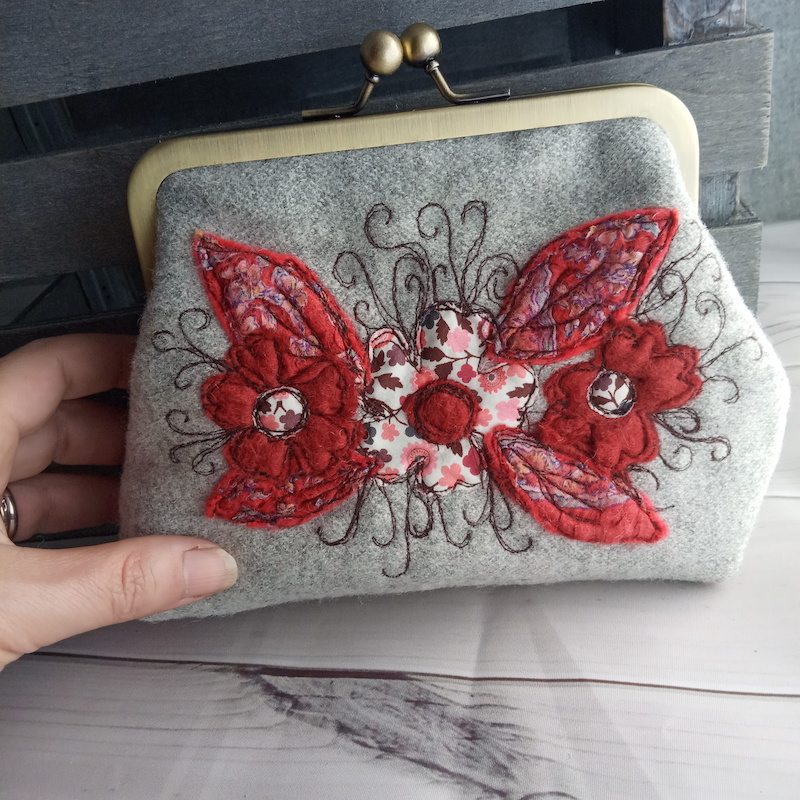 Clasp purse in reds and grey