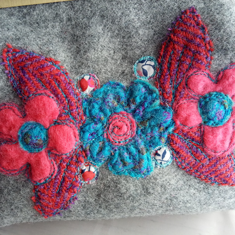 Clasp purse in reds and blues