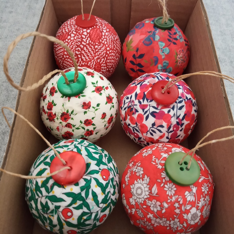 Six red and white Liberty Baubles